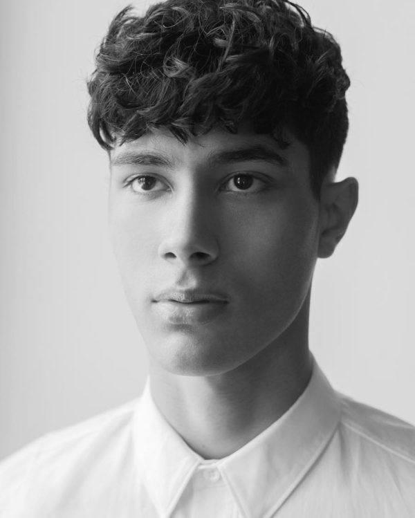 los-mejores-cortes-de-cabello-para-hombre-2016-pelo-ondulado-o-rizado-con-ligero-flequillo
