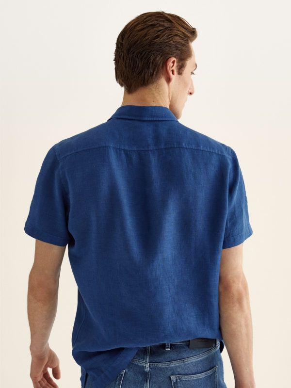 Como vestir elegantemente en verano camisa azul pinzas massimo dutti