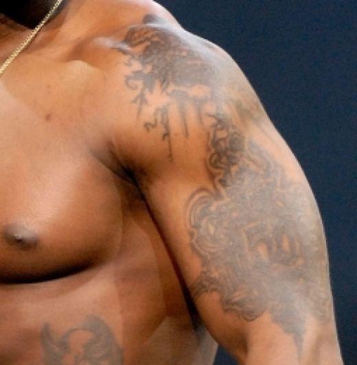 todos-los-tatuajes-de-50-cent-bicep-izquierdo-50