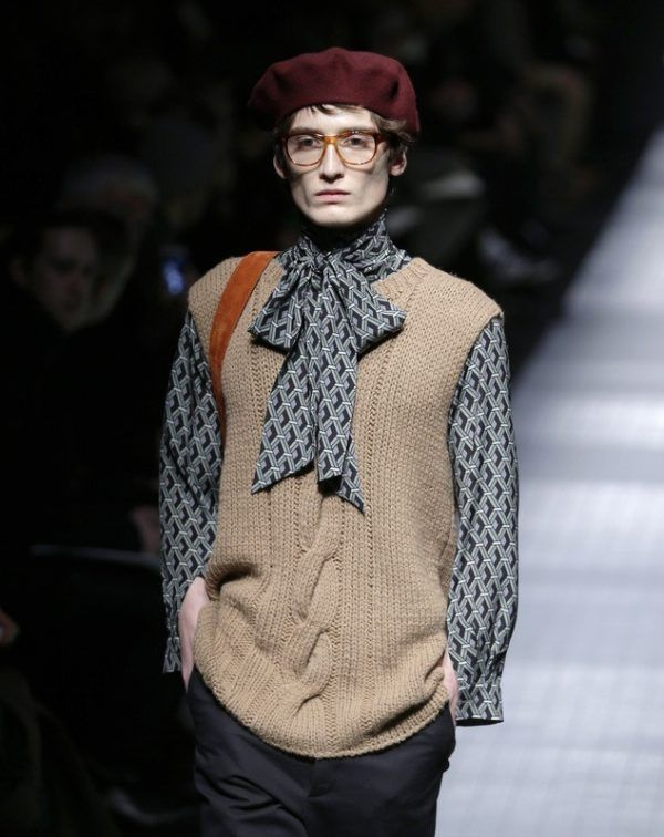 A model wears a creation for Gucci men's Fall-Winter 2015-2016 collection, part of the Milan Fashion Week, unveiled in Milan, Italy, Monday, Jan. 19, 2015. (AP Photo/Antonio Calanni)