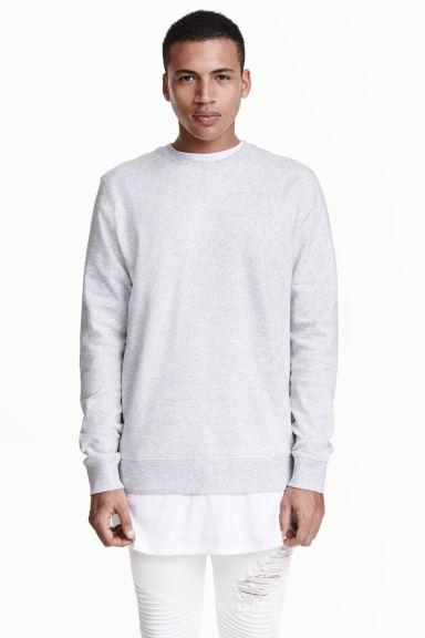tendencias-en-ropa-para-hombre-primavera-verano-sudadera-H&M